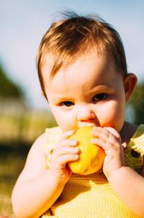 Baby eating a lemon