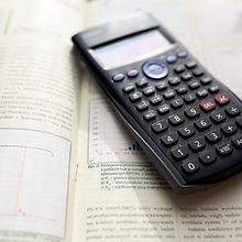 Mathemaics book and a calculator