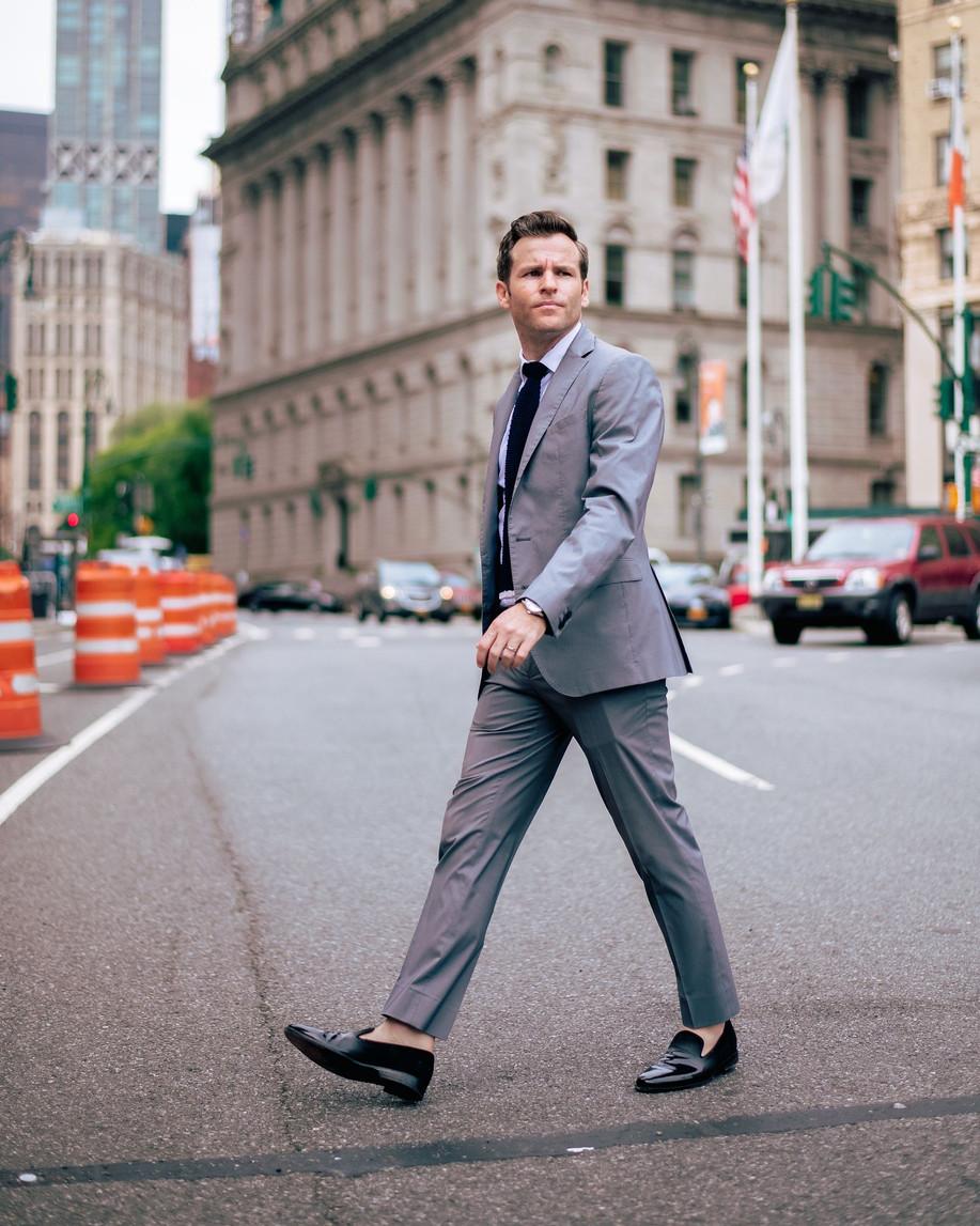 Groom walking streets of nyc elopement w
