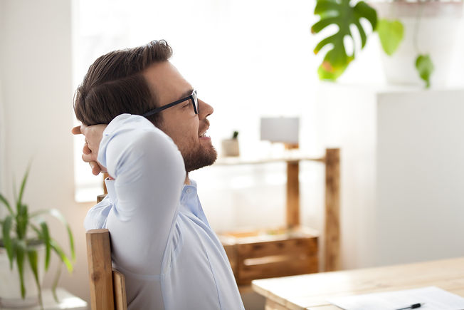 Calm male worker leaning back in chair h
