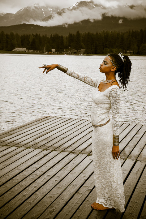 As Theseus bride she stands  /  offering her hand  / to bring order to foriegn lands of Man.