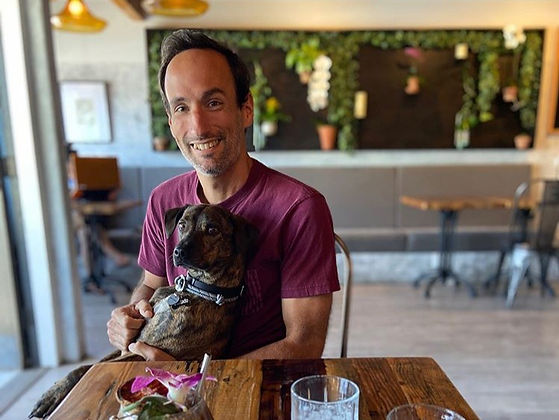 Best Local Chiropractor in Santa Barbara having coffee with his dog