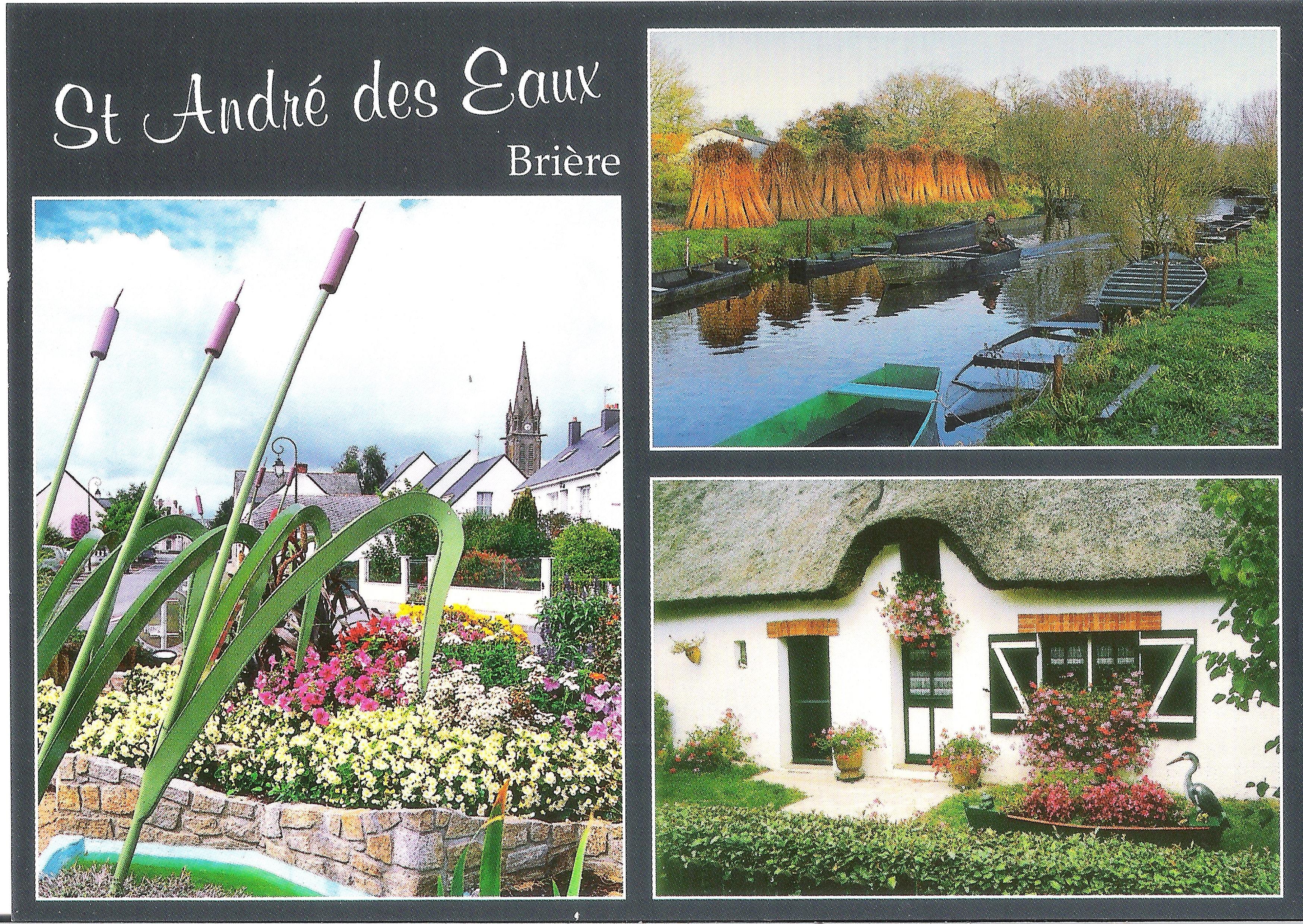 ST_ANDRE_DES_EAUX_-_Commune_du_Parc_Régional_de_Brière_-_Un_rond-point_fleuri,_une_chaumière_et_le_p