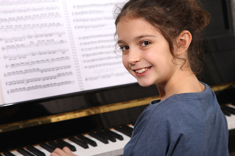 Girl playing piano - Fishers Guitar