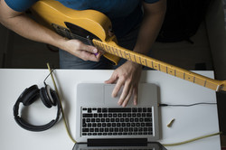 Man teaching himself to play guitar at