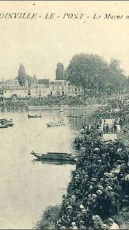 Vue depuis le pont de Joinville un jour de Régate. Avec l'apparition des congés payés en 1936 et jusqu'à la Seconde Guerre mondiale, les bords de Marne sont pris d'assaut par les travailleurs venant profiter des beaux jours au bord de l'eau.