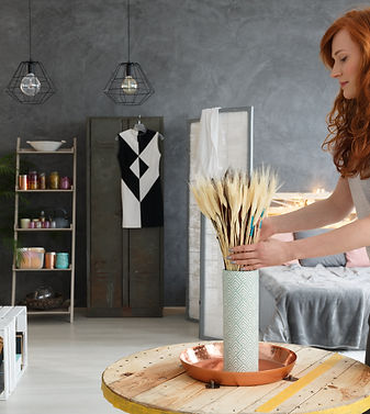 Young woman with red hair decorating con