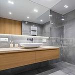 Modern bathroom with wooden countertop,