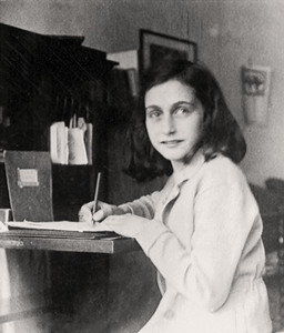 Anne Frank: age between 13 and 14 - writing on her diary.
