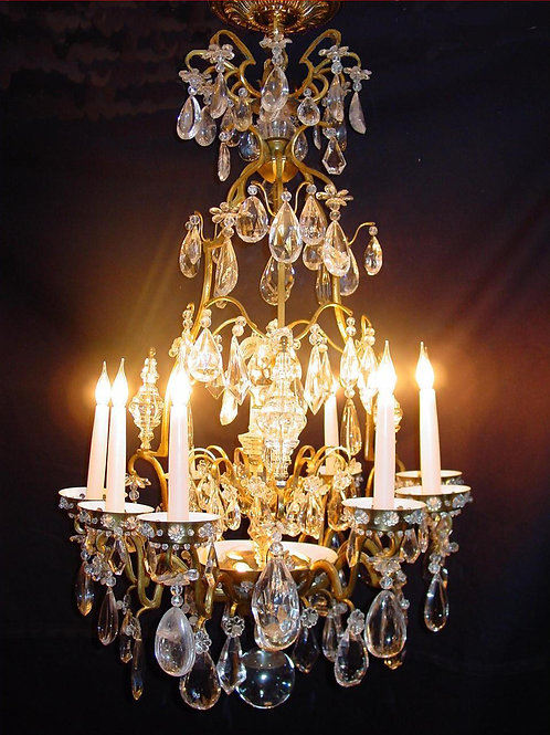 A French gilt and glass chandelier of very rare design in traditional style.