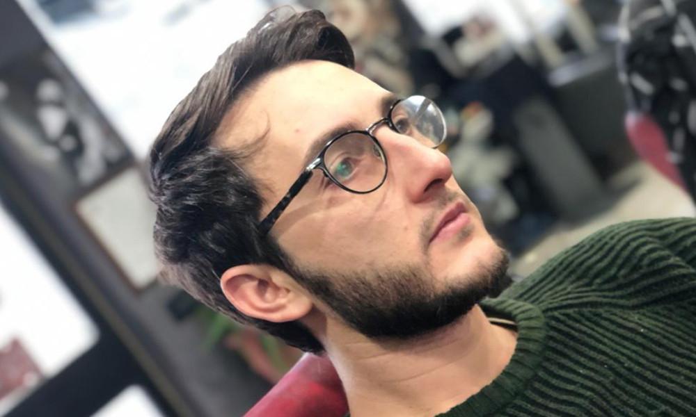 taglio di capelli medio corto per uomo
