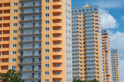 bigstock-New-Apartment-Buildings-106193519