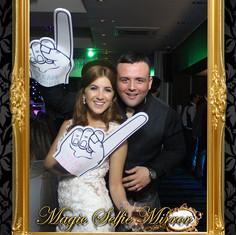 mr and mrs stewart using the selfie mirr