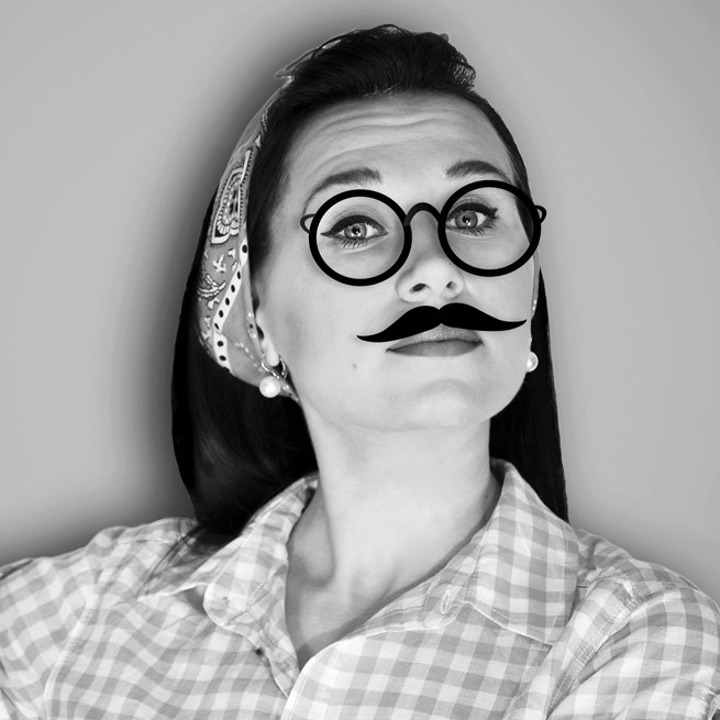 Woman wearing fake mustache