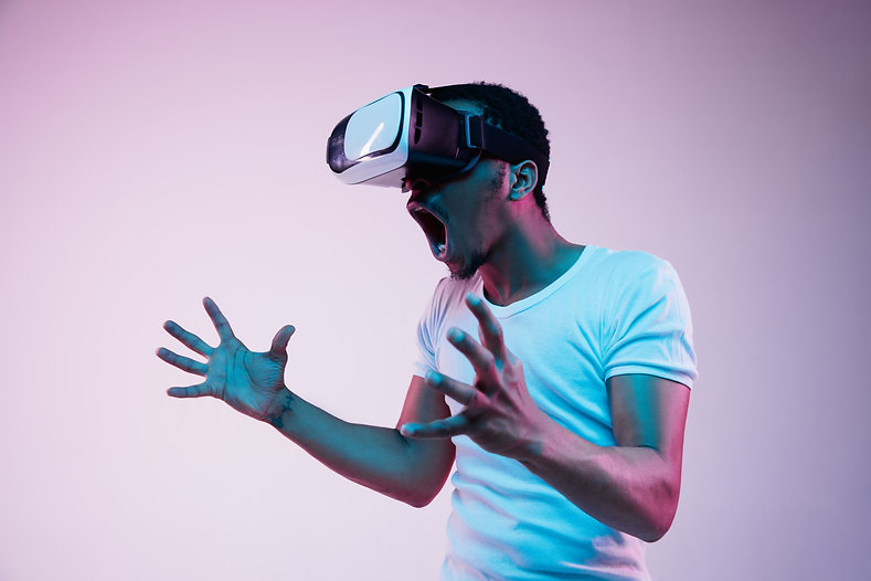 young-african-american-man-s-playing-vr-glasses-neon-light-gradient-background-male-portra