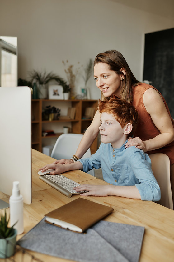 photo-of-woman-and-boy-looking-at-imac-4