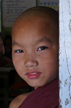 Young Monk at classrroom door