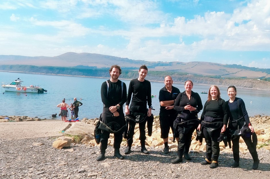 Happy divers on a glorious Jurassic day.