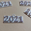 Thumbnail: 3D printed 2021 pins/charms