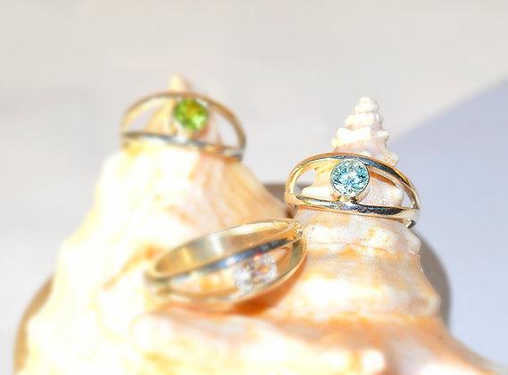 Olivina (verde), Topacio Azul y Circón blanco