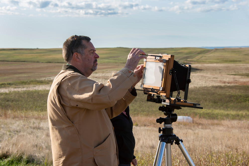 """John Graybill sets up his 6.5""""x8.5"""" view camera for the next shot for the Descendants Project."""