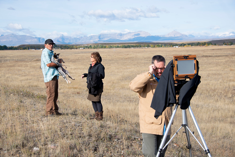 Getting ready to take Peter's portrait out in the prairie land next to his home.