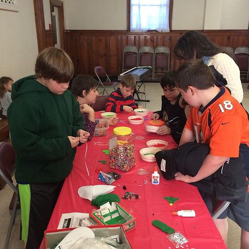 kids making beads.jpg