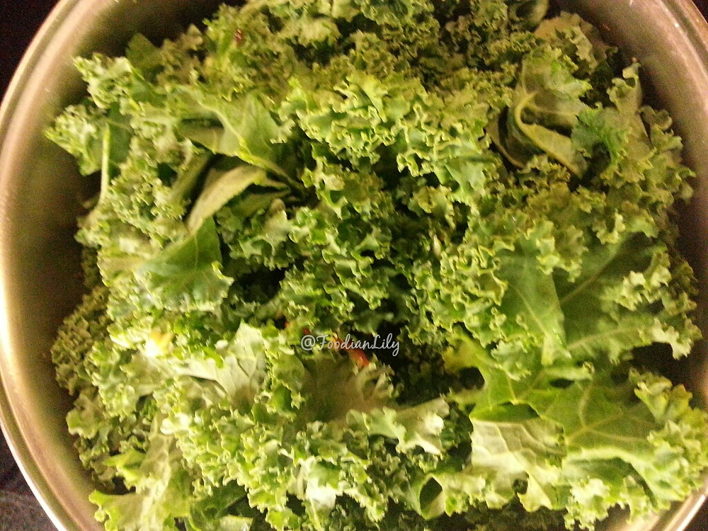 Kale freshly added to the pot