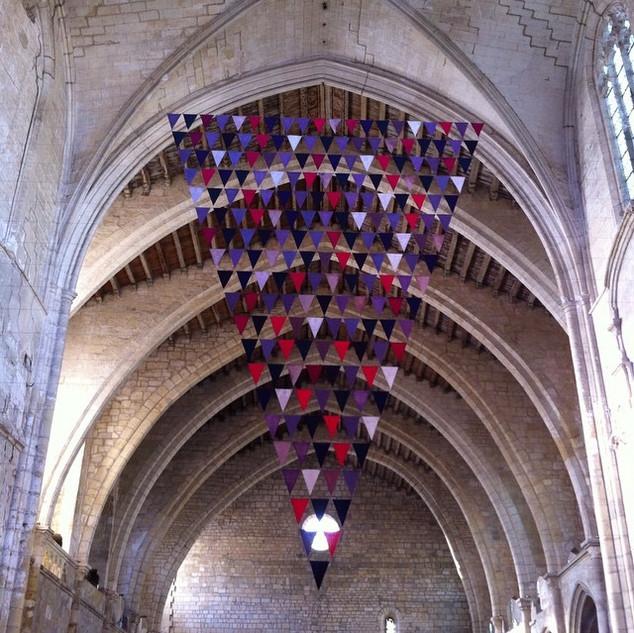 Athina Ioannou; Wine red; Public intervention; Notre-Dame de Lamourguier / Musée Lapidaire; In the context of the exhibition, Manifestation; L'Aspirateur, Contemporary art space; Narbonne (FR);