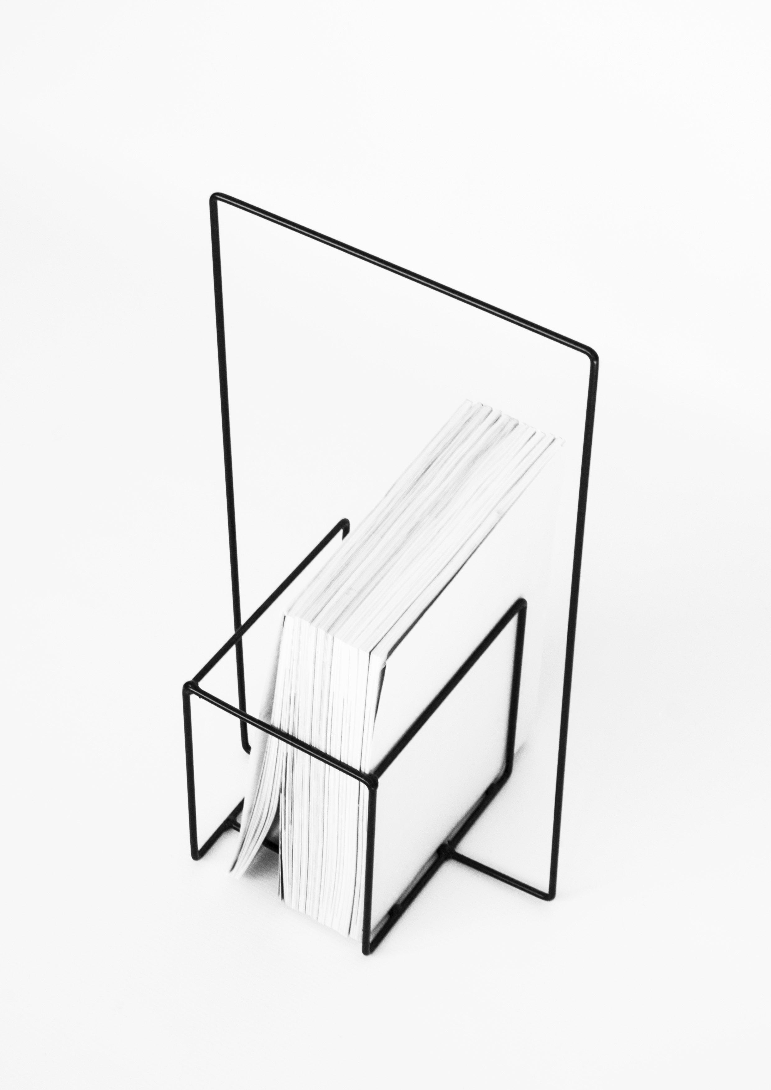 Minus magazine stand