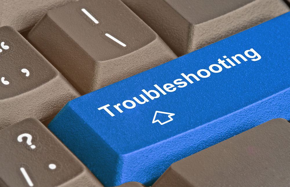 "A blue computer keyboard key labelled ""Troubleshooting"""