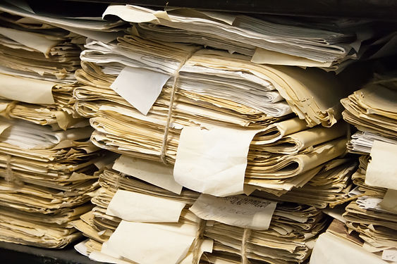 Paper documents stacked in archive.jpg