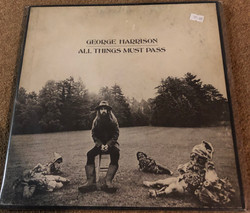 """All Things Must Pass"" by George Harrison."