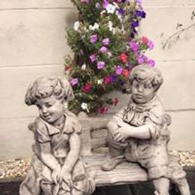 Stone Boy & Girl On Bench