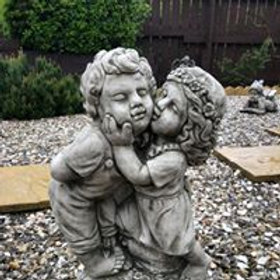 Stone Boy & Girl Kissing