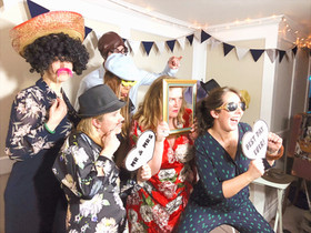 Event guests posing in front of Photo booth