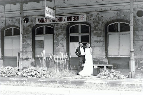 Couple on their Wedding Day waiting for the train