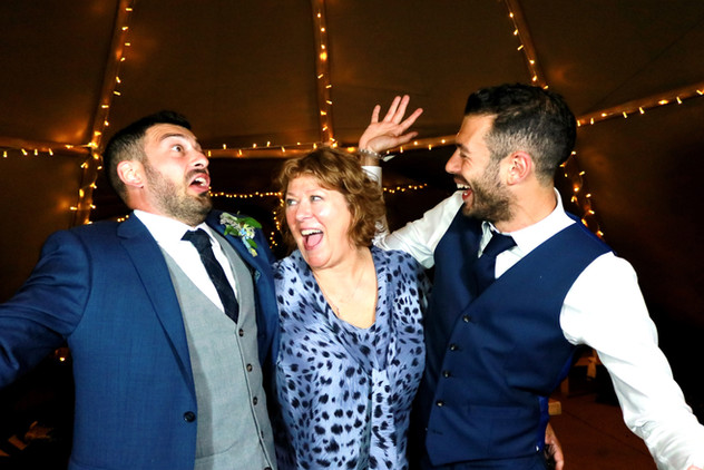 Wedding reception guests, hilarious photo in front of photo booth