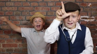 Kids dancing in front of photo booth, taking Boomerang Gif