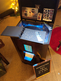 Vintage photo booth printer with guest book