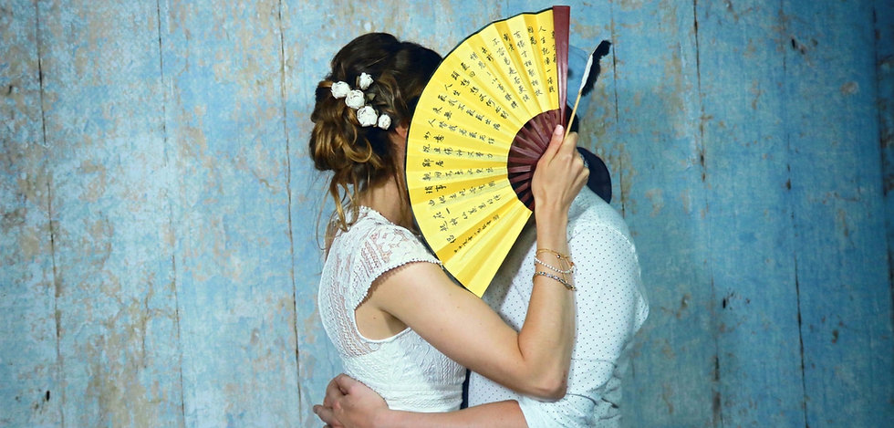 Wedding Couple taking photo booth style shot