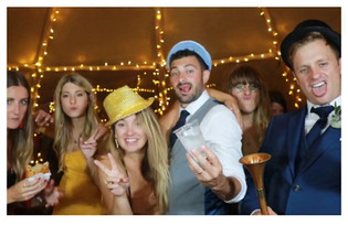 Party guests using fun props