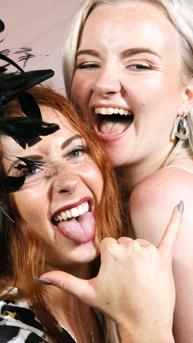 We rock your party, girls taking stylish photo booth image