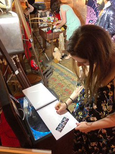 Lady writing words of love into our photo booth guest book