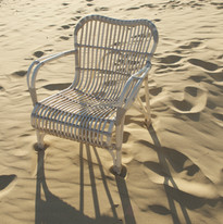 Lazy Lucy sand coloured chair with arms