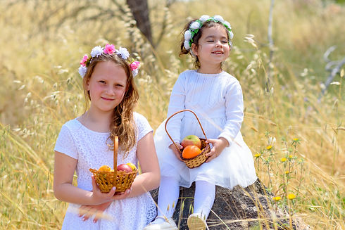Harvest. Shavuot. Two cute smiling littl