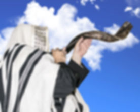 Man blowing Shofar horn for the Jewish New Year h