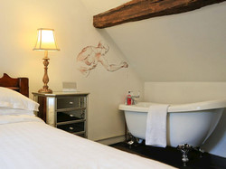 Bedroom with roll top bath - Lea Hall, Matlock