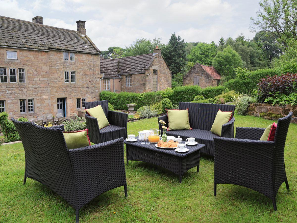Outdoor furniture on an upper lawn - Lea Hall, Matlock