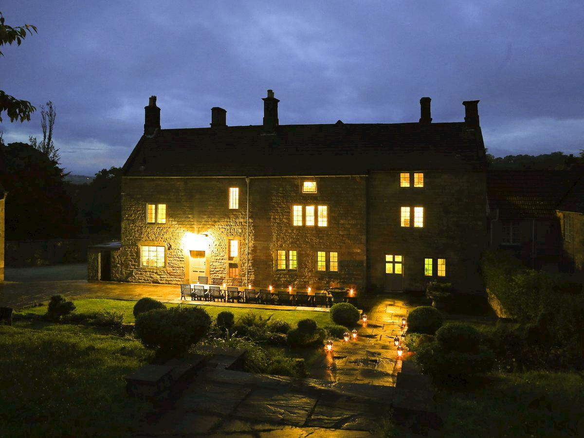 Illuminated rear patio at night - Lea Hall, Matlock